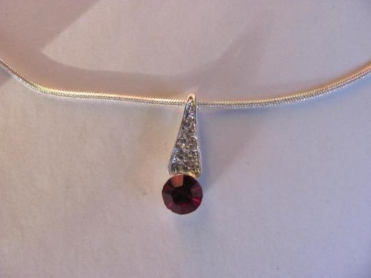 Other NEW. STRIKING PENDANT ON CHAIN
