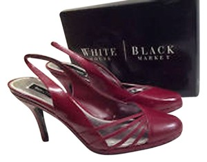White House | Black Market Red Pumps