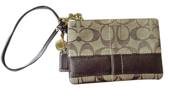 Preload https://item5.tradesy.com/images/coach-none-tan-and-brown-material-wristlet-774049-0-0.jpg?width=440&height=440