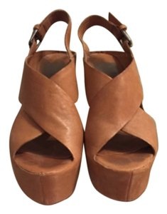 Dolce Vita Tan Platforms