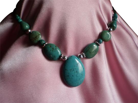Preload https://item2.tradesy.com/images/turquoise-new-magnesite-silver-finished-steel-necklace-778971-0-1.jpg?width=440&height=440