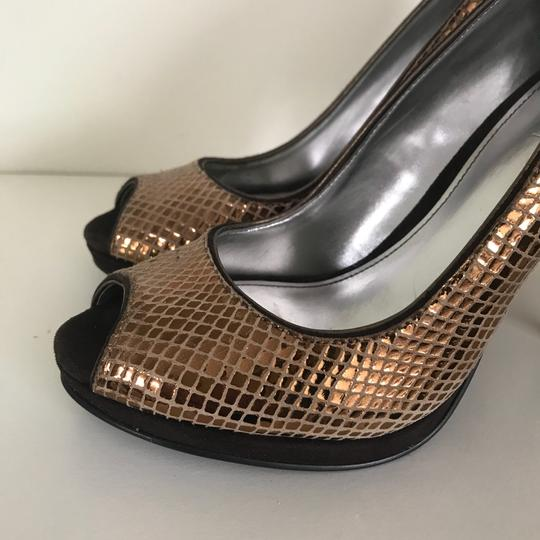 Calvin Klein Size 6 gold Pumps