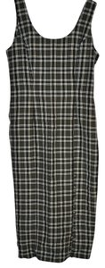 Olive green with a white thread creating a plaid pattern. Maxi Dress by Judy Knapp California 62% 38% Polyester