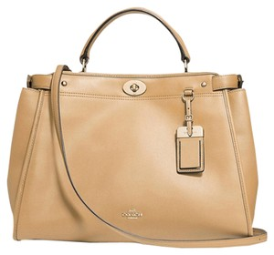 Coach New With Tags Smooth Leather Oxblood Brown Brown Crossbody Strap Handles Turnlock Fabric Lining Satchel in LIGHT GOLD/ NUDE