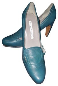 C Label Blue Pumps