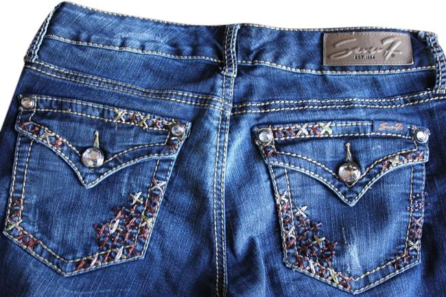 Preload https://img-static.tradesy.com/item/795604/7-for-all-mankind-blue-boot-cut-jeans-size-27-4-s-0-0-650-650.jpg
