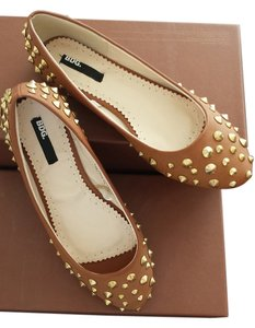 Urban Outfitters Brown and metal spikes Flats