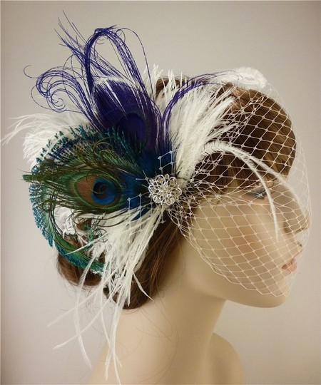 Preload https://img-static.tradesy.com/item/80333/othersilver-feather-fascinator-with-bandeau-veil-hair-accessory-0-0-540-540.jpg