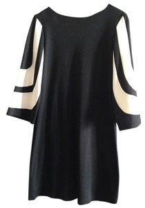 Muse short dress black dress with black and white sleeves. Colorblock on Tradesy