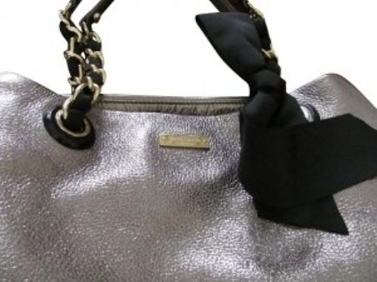 Preload https://item2.tradesy.com/images/kate-spade-bow-regard-maryanne-silver-metallic-leather-tote-8076-0-0.jpg?width=440&height=440