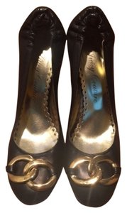 Juicy Couture Gold Leather Round Toe Black Pumps