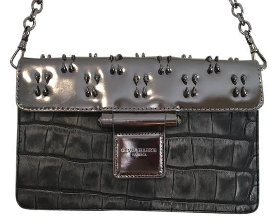Preload https://item2.tradesy.com/images/olivia-harris-crocodile-teeth-detailed-gunmetal-leather-clutch-819266-0-2.jpg?width=440&height=440