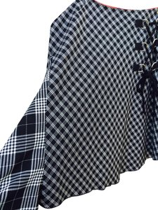 Rocco Barroco Asymmetircal Hem Quirky. Side Detail. Metal Rings. Houndstooth Skirt Black and White