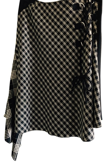 Rocco Barroco Asymmetircal Hem Quirky. Side Detail. Metal Rings. Houndstooth Skirt Black and White Image 1