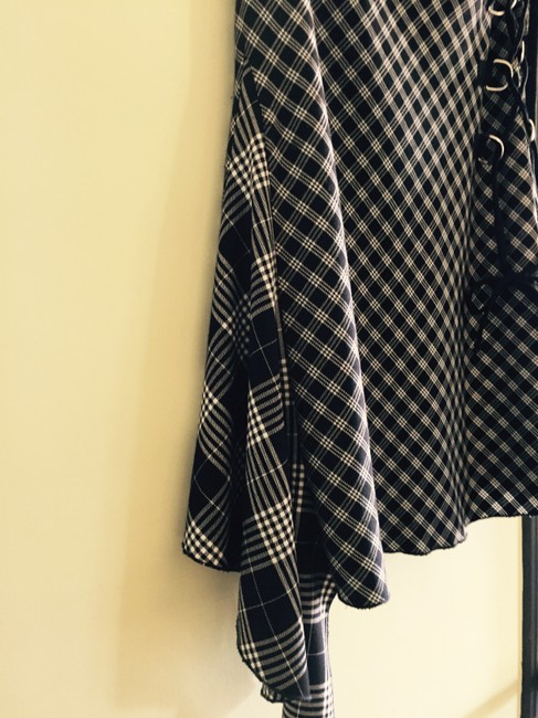 Rocco Barroco Asymmetircal Hem Quirky. Side Detail. Metal Rings. Houndstooth Skirt Black and White Image 2