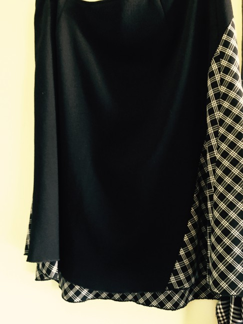 Rocco Barroco Asymmetircal Hem Quirky. Side Detail. Metal Rings. Houndstooth Skirt Black and White Image 3
