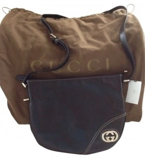 Preload https://item3.tradesy.com/images/gucci-over-adjustable-black-with-light-gold-hardware-and-tan-stitching-leather-body-strap-shoulder-b-8217-0-0.jpg?width=440&height=440