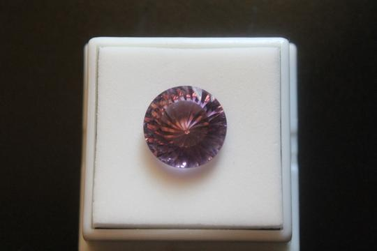 GIA 8.45 ct. 'Spiral' Fancy-Cut Amethyst Gemstone GIA Top Quality