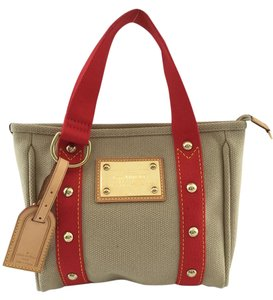 Louis Vuitton Canvas Cabas Pm Satchel in Beige/Red