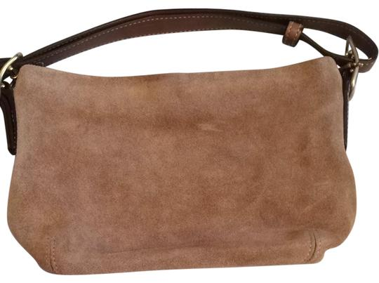 Preload https://item2.tradesy.com/images/coach-brown-wristlet-825966-0-0.jpg?width=440&height=440