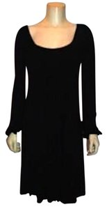 DAISY FUENTES short dress BLACK Knee Length Long Sleeves' Stretchy Mint Condition Nice Medium P75 on Tradesy