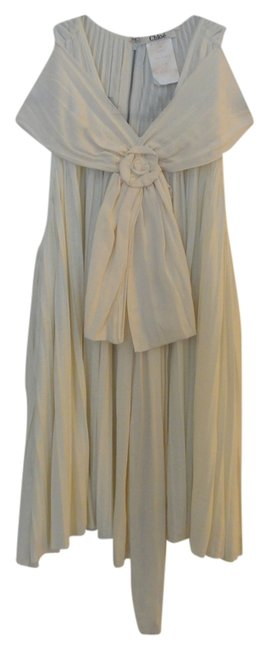 Preload https://item2.tradesy.com/images/chloe-cream-silk-pleated-blouse-size-4-s-833916-0-0.jpg?width=400&height=650