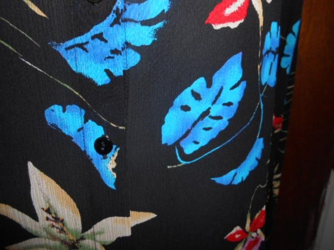 Chico's Top Black background with multicolored floral pattern.
