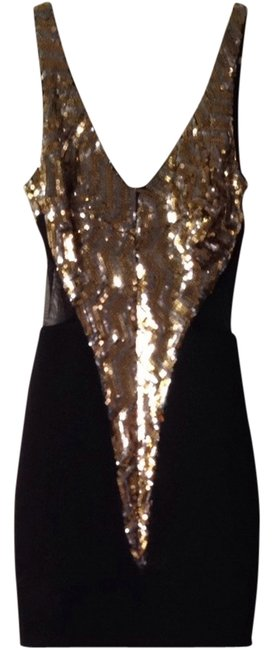Preload https://item4.tradesy.com/images/bebe-gold-black-night-out-dress-size-00-xxs-837958-0-0.jpg?width=400&height=650