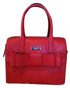 Kate Spade Satchel in Your judgment --mix between red-orange to burnt orange. Your discretion!!!