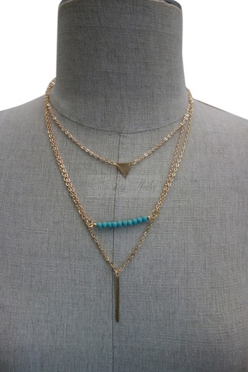 Preload https://img-static.tradesy.com/item/8532466/turquoise-and-gold-santi-statement-necklace-0-1-540-540.jpg