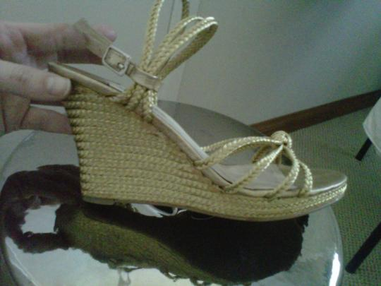 Michael Kors gold Wedges