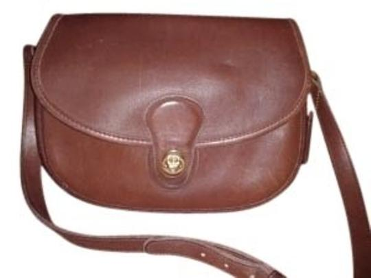 Preload https://item4.tradesy.com/images/coach-vintage-made-in-usa-chocolate-brown-genuine-gloved-tanned-cowhide-leather-cross-body-bag-8613-0-0.jpg?width=440&height=440