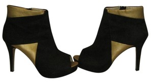 ShoeDazzle black / gold Platforms