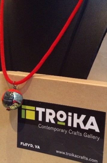 troika Troika Hand painted Charm Necklace On Red Suede