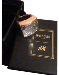 Balmain x H&M BALMAIN x H&M. Chunky ring in gold-colored metal with a faceted glass bead. 80% metal, 20% glass.