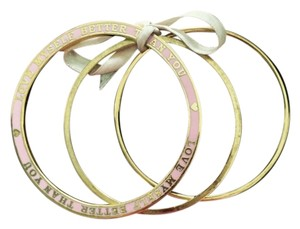 Juicy Couture Juicy Couture Gold Tone and Pink 3 Bangle set
