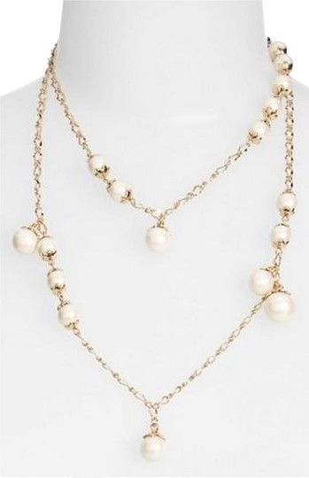 Preload https://img-static.tradesy.com/item/8758492/kate-spade-gold-and-pearls-long-wrap-42-petaled-long-scatter-lustrous-art-nouveau-necklace-0-3-540-540.jpg