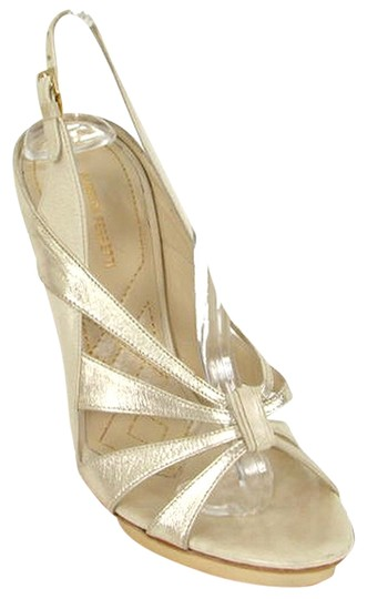 Preload https://img-static.tradesy.com/item/875943/alberta-ferretti-gold-cream-strappy-platform-sandals-size-us-7-0-0-540-540.jpg