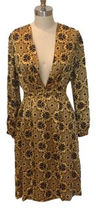 Nieves Lavi short dress Black and gold on Tradesy