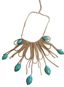 Green gold radiating neckpiece.