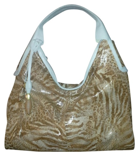 Preload https://img-static.tradesy.com/item/8785279/creamy-tan-and-animal-print-shoulder-bag-0-1-540-540.jpg