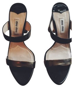 Miu Miu Black and Gold Mules