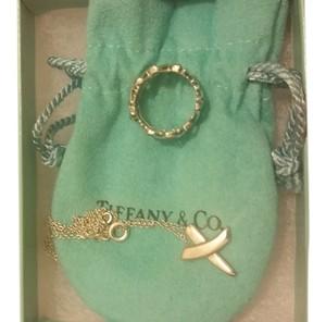 Tiffany & Co. Paloma Picasso's X pendant and Xoxo ring in sterling silver