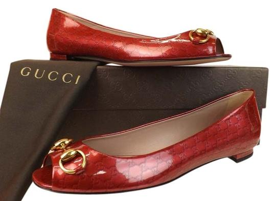 Preload https://img-static.tradesy.com/item/8965627/gucci-red-horsebit-hollywood-raspberry-patent-leather-guccissima-gold-flats-size-eu-385-approx-us-85-0-2-540-540.jpg