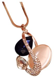 Mixed gems blue sapphire rose gold chain pendant