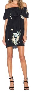 Otis & Maclain short dress black floral on Tradesy