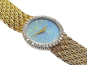 Baume & Mercier Baume & Mercier 18 Karat yellow Gold Watch With 36 Diamonds 0.75 Ct.Tw. & Opal Dial