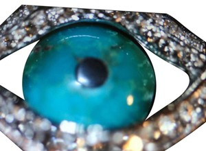 Diamond forever design by auze Beaut y of The stone is mixing wheat diamond ruby turquoise onyx all to get there make gorgeous unique Eyes