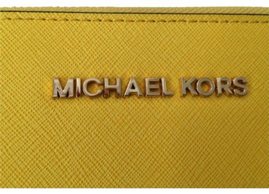 Preload https://item5.tradesy.com/images/michael-kors-jet-set-large-saffiano-wallet-yellow-leather-clutch-9026029-0-1.jpg?width=440&height=440