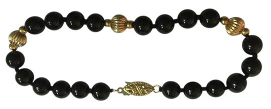 Preload https://img-static.tradesy.com/item/9029881/14k-yellow-gold-and-black-onyx-with-double-safety-filigree-clasp-bracelet-0-4-540-540.jpg